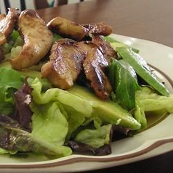 Grilled Chicken Citrus Salad Recipe - A sweet citrus dressing seasoned with chili powder and cumin is used both to marinate the chicken breasts and dress the green salad.