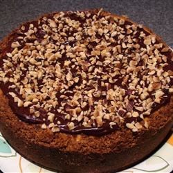 Heavenly Chipped Chocolate and Hazelnut Cheesecake Recipe - A chocoholic's dream.  Something for a very special occasion. You can use hazelnut or chocolate liqueur (or a combination) in this cake.  Originally submitted to CakeRecipe.com.