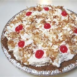 Millionaire Pie I Recipe - The filling for this delicious pie is made with confectioners' sugar combined with beaten eggs, butter, a bit of vanilla, and softened cream cheese. It's spooned into a prepared crust and covered with pineapple- and pecan-studded whipped cream.