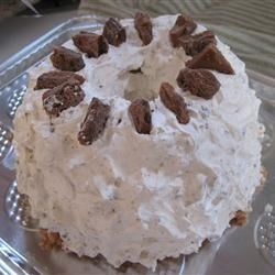Toffee Cake Recipe - This is a great last-minute dessert. A prepared angel food cake is filled with whipped topping and crushed candy bars. If in a rush, you can serve it right away, but it's best if refrigerated for 24 hours to allow the flavors to blend.