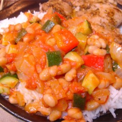 Zucchini Mediterranean Style Recipe - Zucchini, tomatoes, and beans make a tasty topper for rice or egg noodles!