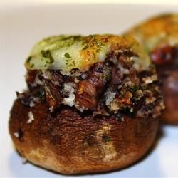 Andie's Stuffed Mushrooms Recipe - Mushrooms are stuffed with herbs, Cheddar cheese and ground beef to make these mouth-watering appetizer bites.