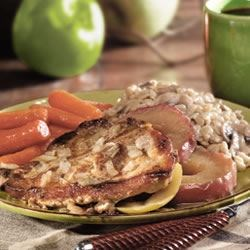 Apple Pork Chops Recipe - A sweet and tangy sauce of brown sugar and mustard with a hint of cloves is the luscious finish to this classic combination of apples and pork baked to perfection.
