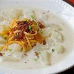 Slow Cooker Creamy Potato Soup Recipe - This is a very rich and creamy soup.  A great family favorite. It may be cooked on the stove or in a slow cooker. Garnish with chives, if desired.