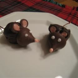 Mice Recipe - Cute chocolate cherry mice have a pointy chocolate kiss face, a cherry stem tail, two little almond slices for ears, and bright red candy eyes.