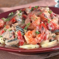 Blackened Shrimp Stroganoff Recipe - Cajun seasoned shrimp are combined with shallots, mushrooms, and roasted red peppers in a simple white sauce served over fettuccini.