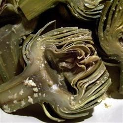 Garlic Sauteed Artichokes Recipe - Artichokes are sauteed in garlic butter before steaming. A simple and delicious way to use artichokes!