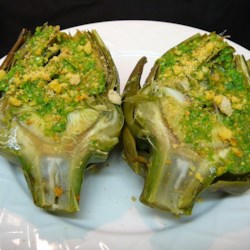 Delicious Artichokes Recipe - These yummy artichokes are drizzled with a pesto butter sauce and sprinkled with seasoned breadcrumbs.