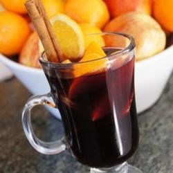 Hot Spiced Christmas Wine Recipe and Video - Mulled or spiced wine is served in many Western and Northern European countries as a part of winter celebrations. Warm your guests this winter with this wine spiced with orange, ginger, and cinnamon