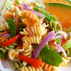 Asian Noodle and Pasta Salad Recipe - When you need a bright and tasty pasta salad, toss rotini pasta with a mixture of oil, sugar and a ramen noodle flavor packet. Thinly sliced carrots and crispy sugar snap peas add color and crunch.