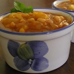 Caribbean White Beans Recipe - This wonderful combinataion of white beans, calabaza, and sazon is bursting with Caribbean flavors!  This dish is great poured over rice, or left thin and eaten as a soup.
