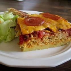 Spaghetti Pizza Lasagna Recipe - Baked spaghetti with ground beef and pepperoni topped with shredded cheese.