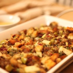 Awesome Sausage, Apple and Cranberry Stuffing Recipe - Freshly toasted bread cubes, turkey sausage, chopped apples and dried cranberry combine to create a tasty fruited stuffing for a 10-pound turkey.
