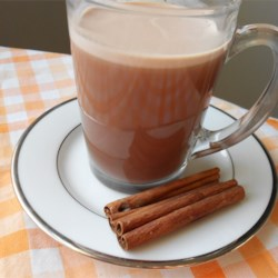 Indian Chai Hot Chocolate Recipe - Put yourself in a holiday mood with this merry drink blending spiced chai tea with hot chocolate.