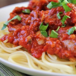 Spaghetti Sauce II Recipe and Video - Take a long afternoon to simmer this rich and savory blend of tomatoes, onions, garlic, basil, oregano, bay leaves, white sugar, red wine and as much red pepper as your taste buds crave. You could add sausages towards the end, or not, as you wish.