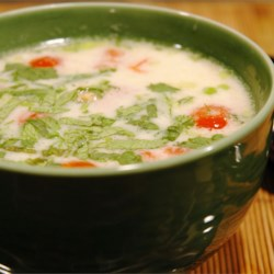 Tom Ka Gai (Coconut Chicken Soup) Recipe - Coconut milk and lime juice seasoned with ginger root and cayenne pepper create a spicy broth for this Thai-inspired soup with strips of white chicken, cilantro and chopped scallions.
