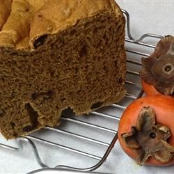 Persimmon Raisin Yeast Bread Recipe - This is not a super-sweet persimmon sweet bread, but a yummy moist raisin bread enhanced with persimmon pulp. Delicious!