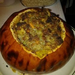 Stuffed Pumpkin II Recipe - This is really a pretty presentation.  I have had many compliments, and it's very easy. Simply hollow out a pumpkin and fill it with your favorite stuffing.