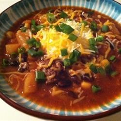 Sweet Pork Slow Cooker Chili Recipe - This chili recipe for the slow cooker makes a slightly-sweet and mild dish that can easily be adjusted for your personal tastes.