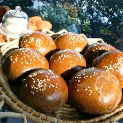 Honey Brown Rolls or Loaves Recipe - Moist and slightly sweet brown dinner rolls get their color from a little cocoa and coffee powder. They're like the favorite rolls served at many famous restaurants. Use your bread machine to do the kneading.