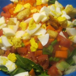 Simple Delicious Salad Recipe - This simple green salad features crisp lettuce tossed with fresh crumbled bacon, diced hard boiled eggs, shredded carrot and sliced tomato, drizzled with oil and vinegar.