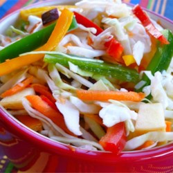 Calico Slaw Recipe - Crunchy cabbage slaw with apples, peppers, and carrots.