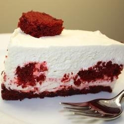 Red Velvet-Center Cheesecake Recipe - Cubes of red velvet cake fill the center of this delicious cheesecake, while red velvet cake crumbs make up the crust.