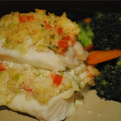 Crab Stuffed Haddock Recipe - An awesome meal for anytime, and especially impressive to guests yet so simple to make.  Haddock fillets are stuffed with a crab and cheese stuffing then baked. A must try - it will be a keeper. Great with salad and rice or potato! Enjoy.