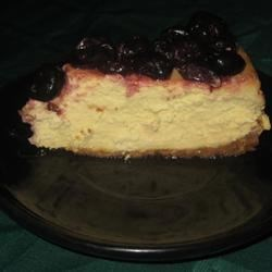 Amaretto Cheesecake III Recipe - A very yummy cheesecake made with amaretto. Serve topped with fresh berries.