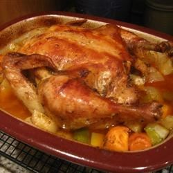 Roasted Vegetable Chicken Recipe - A whole chicken roasted with onion, carrots, celery and potatoes. Delicious any time!