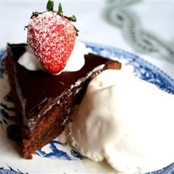 Brownie Torte Recipe - This torte is delicious and very rich with a brownie-like texture studded with walnuts and topped with a chocolate glaze.