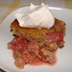 Strawberry Orange Rhubarb Cake Recipe - Rhubarb and strawberries are baked into a moist cake with a hint of orange to make this delicious spring dessert.