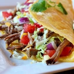 Green Chile Beef Tacos Recipe - Beef chuck roast, taco seasoning mix, green salsa, and beef broth are all you need in your slow cooker to make a terrific taco filling.