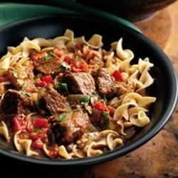 Hungarian Goulash III Recipe - Beef stew meat and onion are seasoned with paprika and brown sugar in this traditional Hungarian dish.