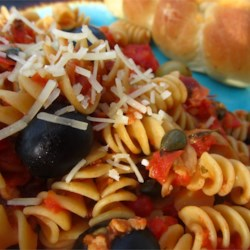 Pasta Rustica Recipe - Lindsay(R) Black Olives or Lindsay(R) Green Ripe Olives - or even a mixture of both - are tossed into this Pasta Rustica, bringing together the flavors of sweet bell pepper, mellow olive oil, and spicy pepper flakes. Finish with Parmesan cheese, and enjoy!