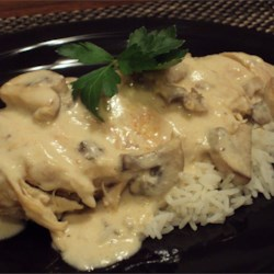 Mushroom Chicken in Sour Cream Sauce Recipe - Chicken breasts seasoned with paprika, lemon pepper, and garlic powder are slow cooked with white wine, sour cream, mushrooms, and cream of mushroom soup in this easy-to-prepare recipe that cooks while you go about your day.