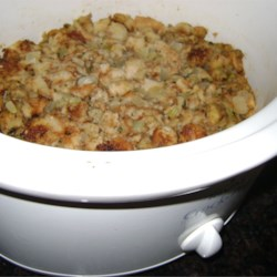 Stuffing for Slow Cooker Recipe - Sauteed celery, onion, parsley and mushrooms are lightly packed with bread stuffing into the crock of a slow cooker in this recipe which saves time and oven space.