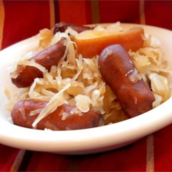 Sauerkraut and Smokies Recipe - Sauerkraut and little smoked sausages simmer for hours in a sweet, tangy sauce flavored with cola soda in this easy, make-ahead slow cooker meal that's great for game day.