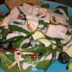 Spinach and Chicken Salad Recipe - Fresh spinach, topped with chicken, zucchini, bell peppers, olives, and cheese. A tasty salad that's quick and easy to make.