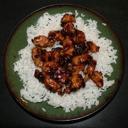Whiskey Chicken Recipe - Sauteed chicken chunks braised in a sweet, savory whiskey sauce.