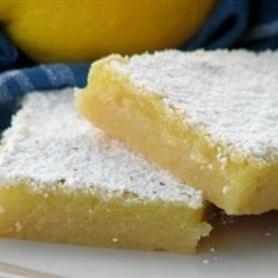 The Best Lemon Bars Recipe - These tart, rich lemon bars need just seven common ingredients you probably already have, and are done in 55 minutes!