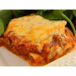 My Mom's Lasagna Recipe - Time consuming, but worth it.  This is a recipe my mom only makes for holidays or when her kids come home to visit.  The sauce is better if you make it the day before and let it sit over night.  You can make this ahead of time and freeze for a few weeks before you bake them.  Serve in large squares smothered with any left over tomato sauce and a little parmesan on top.