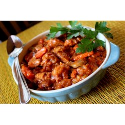 Bachelor's Stew Recipe - Cubes of beef chuck tossed in seasoned bread crumbs are cooked for 10 hours in a slow cooker with vegetables, condensed tomato soup, soy sauce and quick cooking tapioca in this easily assembled stew.
