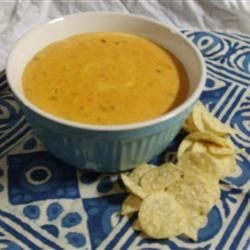 Jeff's Chili Con Queso Recipe - This simple cheese and chili dip is great with tortilla chips or French bread. It may be prepared and served in a slow cooker, if desired. A fondue pot also works well for keeping the finished dip warm.