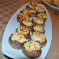 Crab Stuffed Mushrooms Recipe and Video - This tasty appetizer seasoned with thyme, oregano, and savory.  Choose good sized mushrooms, about 2 inches across.  When cleaning mushrooms, don't run them under water.  They are like little sponges, and will absorb it; just wipe them clean with a damp towel.  The filling can be made with fresh, canned, or imitation crabmeat.  If using canned, be sure to rinse it first.