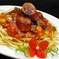 Sweet Italian Sausage Ragout with Linguine Recipe - Zesty sausage is simmered with a colorful blend of bell peppers, onion, and tomato in this amazingly rich pasta dinner.