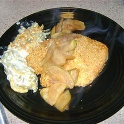 Lemon Pepper Pork Chops Baked and Served With Apples Recipe - A pork chop is flavored with lemon pepper and coated with a crunchy breading, then baked. It's topped with cinnamon/allspice apple slices. How can pork and apples not be wonderful together?