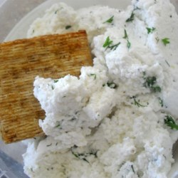 Garlic and Basil Goat Cheese Recipe - This basil- and garlic-infused goat cheese is so good that you won't want to stop eating it!