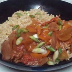 Spanish Chicken Recipe - Chili sauce really jazzes up this tomato vegetable sauce served with chicken over rice.