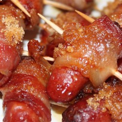 Brown Sugar Smokies Recipe and Video - Mini smoked sausages disappear extra quickly when blanketed in crisp bacon and topped with a brown-sugar glaze.
